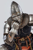 Bored knight lean on his fist — Stock Photo