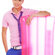 Well looking male model lean on pink summer mat - Stok fotoğraf