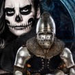 Stock Photo: Dark skulled face womand iron knight