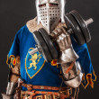 Stock Photo: Knight in blue with dumbbell