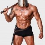 ������, ������: Hot warrior in black pants is holding sword in his shoulder