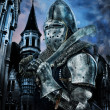 Stock Photo: Knight with sword near to castle