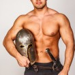 Topless man with helmet and sword — Stock Photo #23005002
