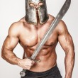Shirtless barbariant with angry smirk - Stockfoto