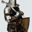 Stock Photo: Knight is posing on white background