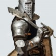 Stock Photo: Profile photo of knight with sword on his shoulder