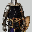 Stock Photo: Standing armored knight in grey background