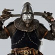 Knight is holding sword behind his back - Stockfoto