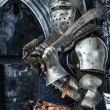 Stock Photo: Armored knight with his sword