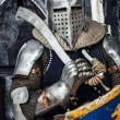 Portrait of armored man with sword and shield — Stock Photo