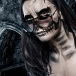 Skull faced girl on a castle background — Stock Photo