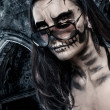 Skull faced girl on a castle background — Stock Photo #23005180