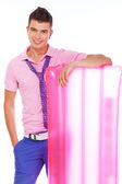 Well looking male model lean on pink summer mat — Stock Photo