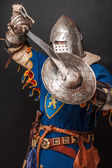 Knight is demonstrating his shield and sword — Stock Photo