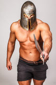 Shirtless barbarian provokes for a duel — Stock Photo