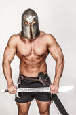 Screaming barbarian holding his sword — Stock Photo