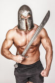 Shirtless barbariant with angry smirk — Stok fotoğraf