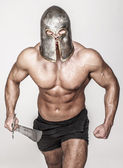 Angry barbarian with veined body — Stock Photo