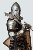 Profile photo of knight with sword on his shoulder — Stock Photo