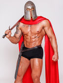 Serious warrior with hot body — Stock Photo