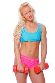 Cute fit blond woman with red dumbbells — Stock Photo