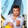 Young gorgeous man with a key from his apartment — Stock Photo #23662697