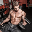Bodybuilder is having work out — Stock Photo