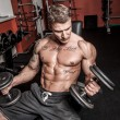Stock Photo: Bodybuilder is having work out