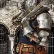 Armored knight with his sword — Stock Photo