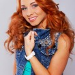 Постер, плакат: Attractive redhead in stylish casual clothing