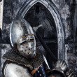 Stock Photo: Armed knight on ancient building background