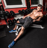 Shirtless hottie is resting after the hard training — Stock Photo
