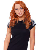 Hot redhead girl with nice hairstyle in tend black shirt — Stock Photo