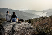 Are sitting on the mountain and looking on the horizon — Stock Photo