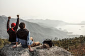 Two friends are happy that they got on top of mountain — Stock Photo