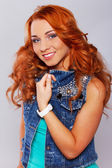 Attractive redhead in stylish casual clothing — Stock Photo