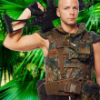 Armed soldier in uniform in the jungles - Stock Photo