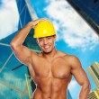Hot shirtless hardworker in hardhat in town - Zdjęcie stockowe