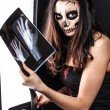 Foto Stock: Zombie girl and x-ray image