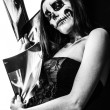 Colorless picture of female zombie and x-ray images — Stock Photo