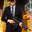 Min suit with gun is ready to kill — Stock Photo #23869255
