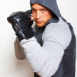 Young man is taking boxing poses — Stock Photo