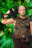 Armed soldier in uniform in the jungles — Stock Photo