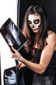Zombie girl and x-ray image — Stock Photo
