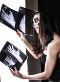 Zombie girl is discovering x-ray images — Stock Photo