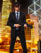 Tall professional killer with a rifel — Stock Photo