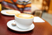 Coffee cup with a drawing on it — Stock Photo