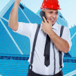 Stock Photo: Businessman in red hardhat is arguing on the phone