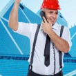 Businessman in red hardhat is arguing on the phone — Stock Photo
