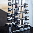 Royalty-Free Stock Photo: A stand with different weight dumbbells